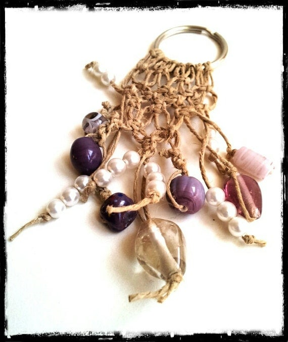 Keychain pendant woven with natural hemp featuring purple shaded beads and white pearls