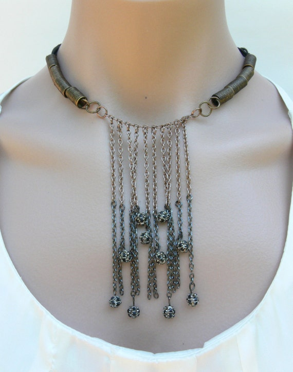 Metal chain bib style necklace with black crystal spacer beads and cord strands