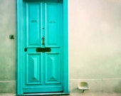 turquoise old door in Nice, South France framed in white wooden frame