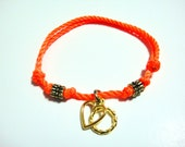Heart Charm and Gold Donut Rings on Orange Neon Bolo Cord
