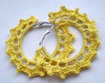 Light yellow crocheted earrings in the form of rings
