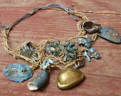 Chunky necklace with gold colored crochet and blue-gold hand painted natural shells