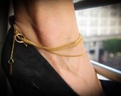 Gold layered anklet with indian hand accents