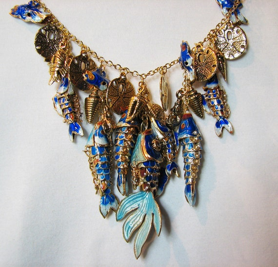 Enamel fish charm bib necklace. Blue and aqua. Gold chain. Sea life. Casual swimsuit beach jewelry.
