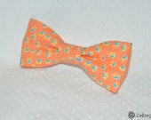 adult easy clip on bow tie - peachy orange with yellow and blue pattern, and white mini polka dots