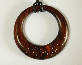 Ironwood circle pendant with silver inlay