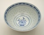 Beautiful porcelain blue and white chinese bowl with transparent light blue ovals