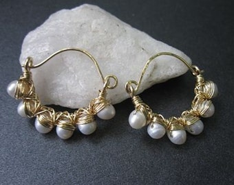 Hammered hoops wrapped with ivory pearls Cosmopolitan 43