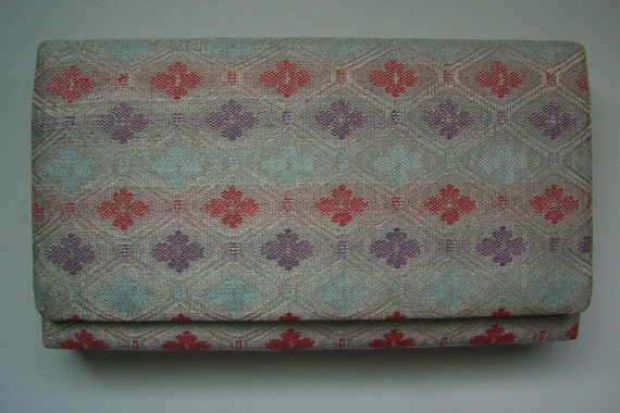 1960s vintage Japanese brocade clutch purse in silver, mauve, pale blue and orange brocade