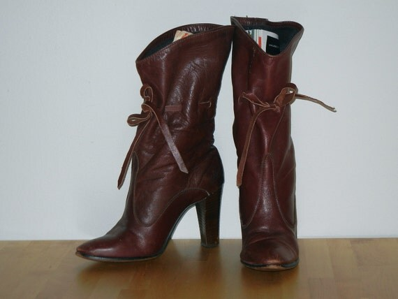 Vintage 70's dark red leather high heeled boots.