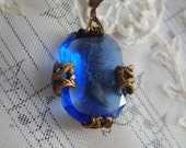 Beautiful cobalt blue glass cameo ,brass filigree and chain