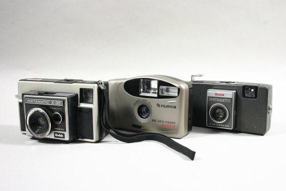 Three (3) Vintage Point and Shoot Cameras   - Kodak Instamatic and Fuji