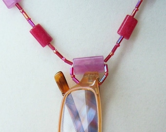 Specs necklace holds your reading glasses