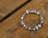 Pink charm bracelet (like Pandora without the price)