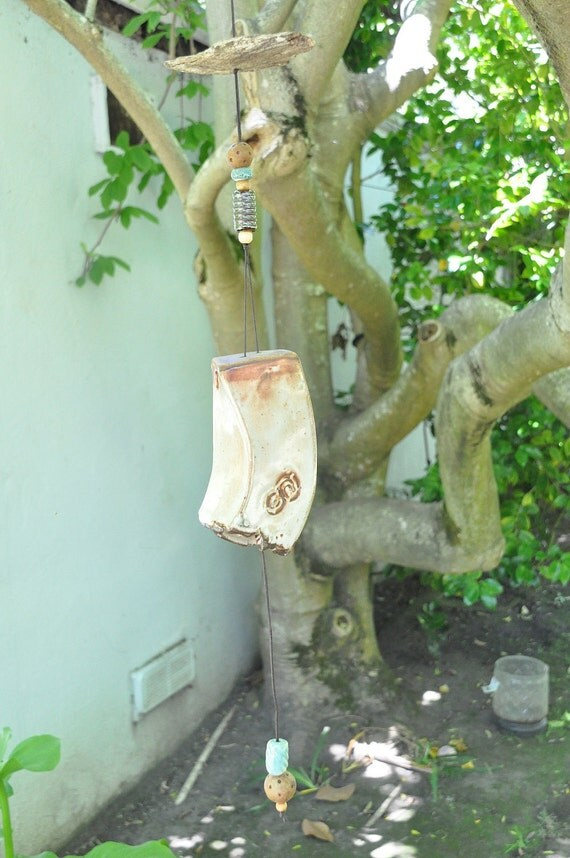 Ceramic wind chimes, with cream-orange-brown Shino glaze, rough edges and ceramic beads
