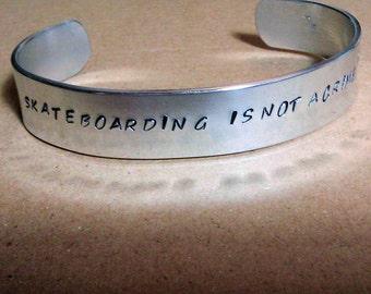 Skateboarding Is Not A Crime -  Metal Stamp Bracelet (hc3.8S)