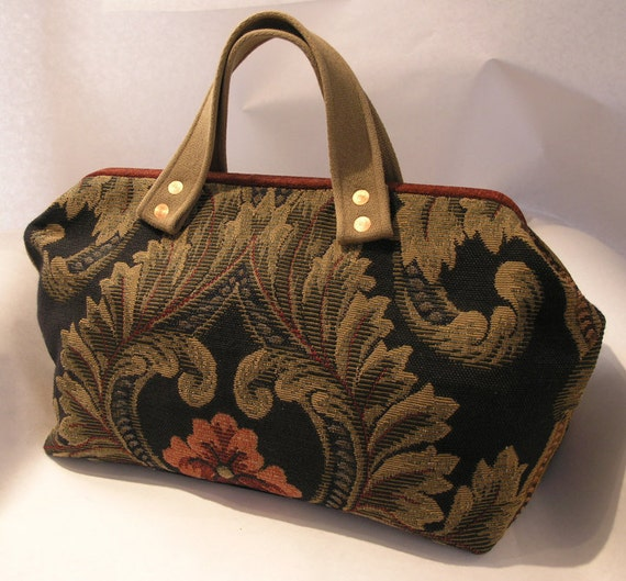 Gorgeous carpet bag in a baroque style tapestry of black, dusty gold, and red.