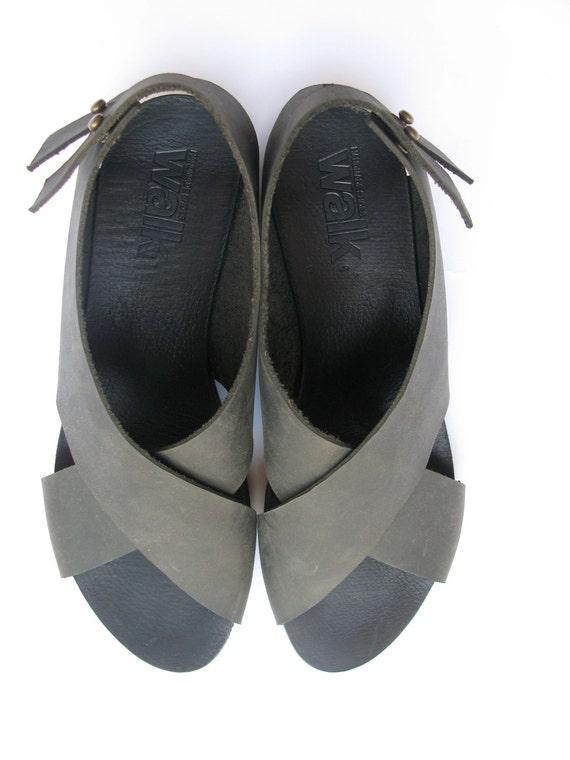 Black crossed leather sandal.