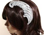Adjustable silver sequin feather fascinator headband
