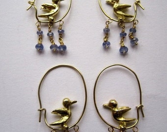 Hooped singing bird earrings in 18ct gold