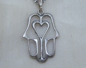 Sterling Silver Hamsa Pendant Necklace With Heart Shaped Design