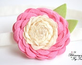 Camille. A camellia flower of pink and cream trim with apple green velvet leaves. Newborn prop, headband, clip, brooch pin. Spring