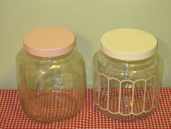 Two Large Retro Glass Storage Jars. Pink Lid.  Ivory Lid.