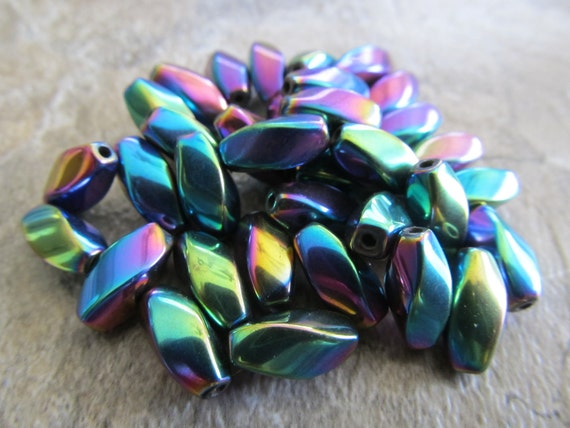 """Magnetic Hematite, Multi-Colored, 12x6mm Twisted Ovals, 8"""" Strand"""