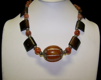 Dramatic  African Amber with Mahogany Wood slices and Carnelian Beads