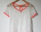 SALE: ReMade - Upcycled White lace t-shirt with fluorescent orange piping and hand embellished pearl details