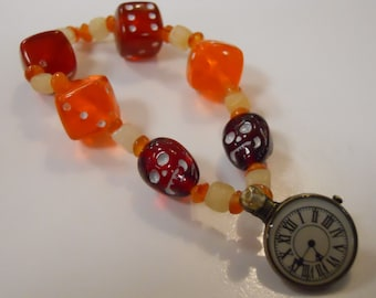 The Real Dia de los Muertos Later Than You Think steampunk beaded stretch bracelet with Czech glass skulls, steampunk clock face & dice