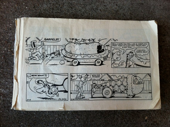 Vintage orange cat Garfield comics with odie, by Jim Davis can be used for craft paper, paper ephemera, decoupage, or mixed media art
