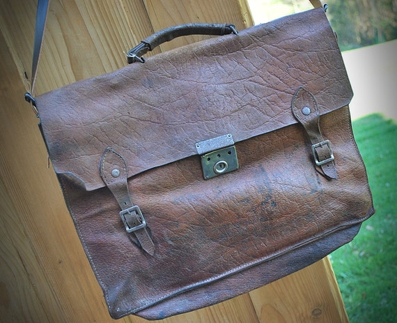 old leather schoolbag for notebook