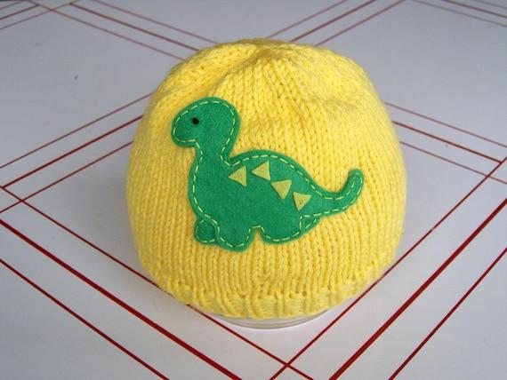 Yellow knit newborn hat with dinosaur