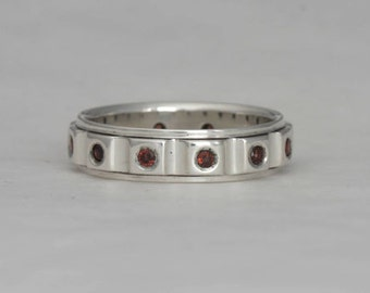 Garnet band, size 8 3/4 ring with twelve 2 mm garnets, #143.
