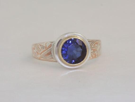 Size 7 1/2 mokume gane ring with manmade saphire, number 66.