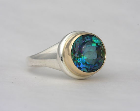 Size 9 ring with a 12mm rainbow topaz, number 115.
