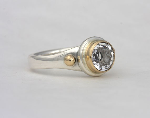 Size 9 ring with a 8mm white topaz and 2mm garnet, number 116.