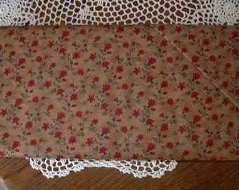 Dark  Tan Background with Red Flower Vine by Barbara Brackman for Moda