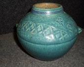Round turquoise vase