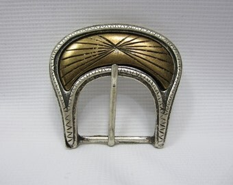 Belt Buckle -  with a brass inlay in a Silver coloured metal made in Italy in the 90's