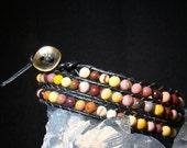 Mookaite Jasper 4mm stones wrapped in Greek leather creating a triple wrap bracelet