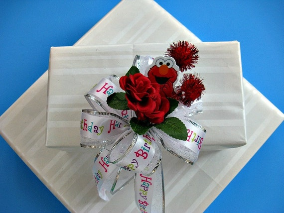 Child's Birthday party bow with Elmo, red roses and fuzzy pom poms (HB17)