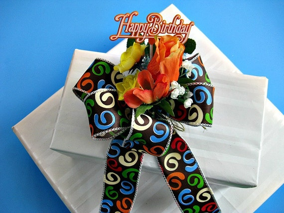 Orange giftr wrap Birthday bow with multicolored swirls on a chocolate ribbon (HB3)