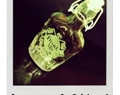 DRINK ME. 8.5 oz Hand Etched Swing Top Glass Flask.
