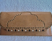 Natural leather eyeglass case with wood bead inlay.