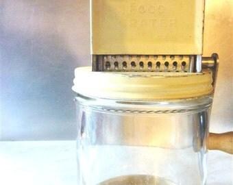 Vintage yellow Metco food grater nut grinder