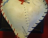 Hanging HEART. Made with upcycled  softball skins. from LOVELAND,COLORADO.