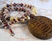 Aluminite necklace with burnt jade bagua pendant