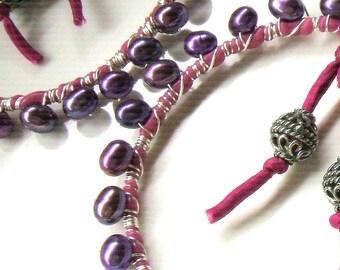 Large hoop earrings embellished with purple pearls